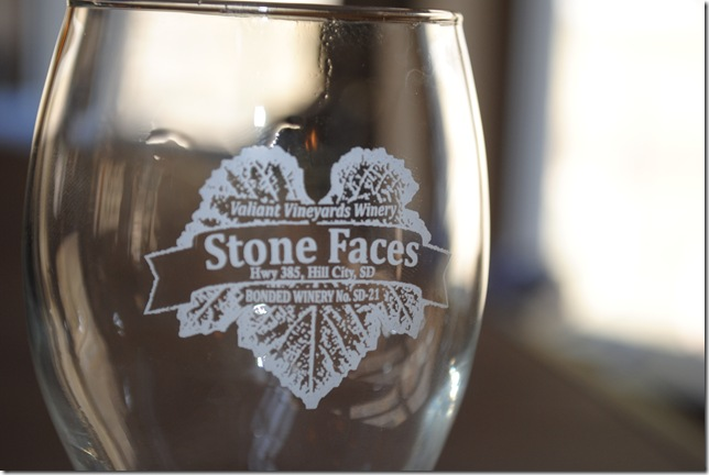 photo of a wine glass at Stone Faces Winery